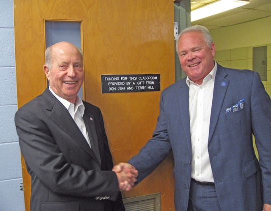 Dallas resident Don Hill (left) is an alumnus of Louisiana College, whose president Dr. Rick Brewer (right) expressed his gratitude for the generosity of Don and Terry Hill for underwriting the remodeling and equipping a computer science classroom at the Pineville campus.