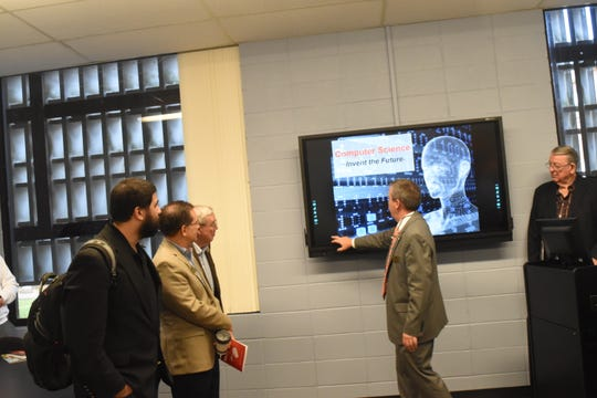 Louisiana College's CIO and Vice President for Information Technology Mark Shoemaker (second from right) gives a demonstration to the LC board of trustees of the new computer equipment to available in the remodeled Computer Science classroom that was donated by alumnus Don Hill and his wife Terry.