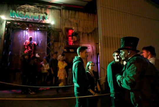 Customers wait outside the Burial Chamber in Neenah during a recent Halloween season.