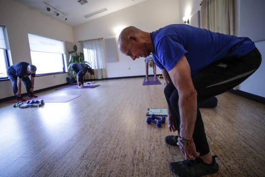 Yoga instructor Bill Miller, 74, teaches a strength training class to a group of retirees at the 5 Koshas Yoga & Wellness in Wausau.