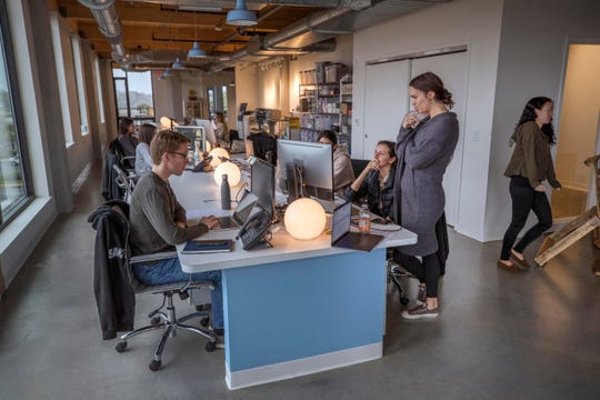 Workers discuss project. The Sawtooth Group, a digital marketing firm in Red Bank, is the first tenant to move into the Anderson Building, a former warehouse that has become one of the hottest properties in Red Bank.