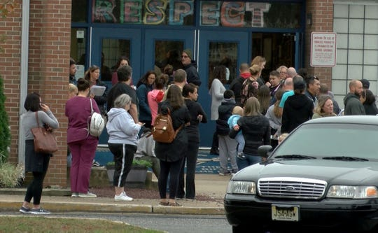 Parents wait outside Lanes Mill Elementary school to pick up their childen.  This is just down the street from Brick Memorial High School where a 16 year old student ran after being grazed in shooting Tuesday afternoon, October 22, 2019.