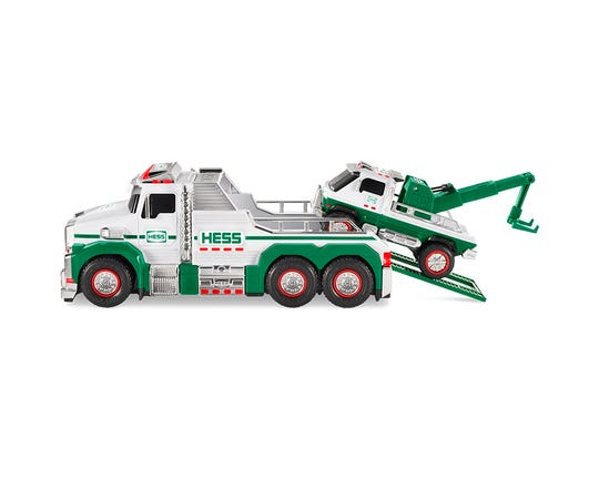 The little tow truck can get a lift, via the handy ramp on the 2019 Holiday Hess set.