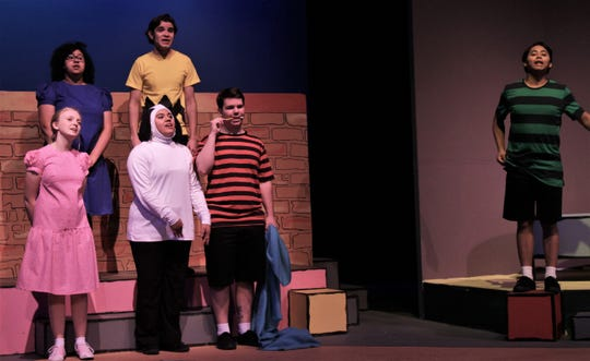 "Schroeder (Elmer Mejia, right) leads his friends and a dog named Snoopy in singing ""The Glee Club"" in McMurry University's homecoming musical ""You're a Good Man, Charlie Brown."""