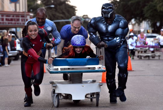 The all-Marvel-costumed Big Country Medical Society races to the finish in the 2nd annual Great Gurney.