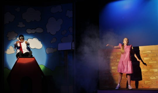 "The World War I flying ace (Snoopy, Victoria Picon) comes under attack, much to the display of a woman on the ground (Sally, Madi Melbourne) in McMurry University's homecoming musical ""You're a Good Man, Charlie Brown,"" which is on stage this weekend at Ryan Little Theatre."