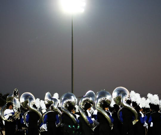 The lights of Wyiie ISD's Bulldog Stadium shine off the Cooper marching band tubas as the band gets into position to open its show Monday night at the Region VI marching band competition. Oct 21 2019