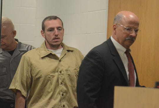Thomas Swarmes follows his attorney, John Sullivan into the courtroom on Tuesday.