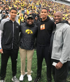 Former Battle Creek Central hoop legend Kenyon Murray, right, with his twin sons Kris and Keegan on a recruiting visit at the University of Iowa.