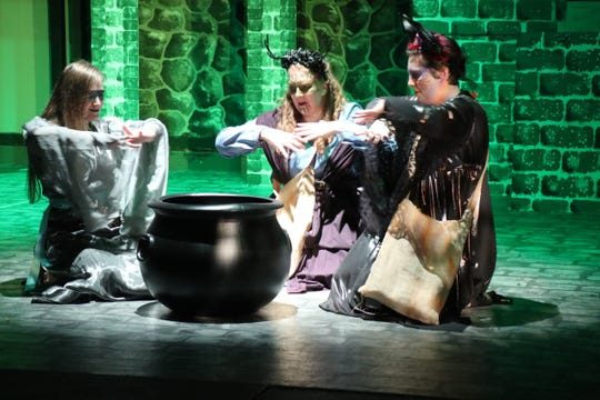 The witches (from left, Eliora Lukkasson, Ali Budge and Jillian Maynard) boil up some toil and trouble for Macbeth.