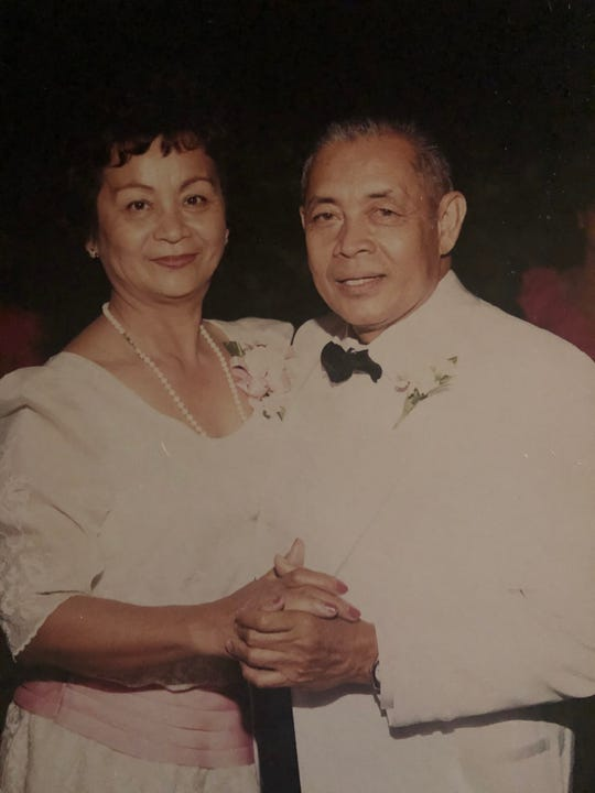 Leonila and Alfonso Baes dance during their daughter's 1985 wedding.