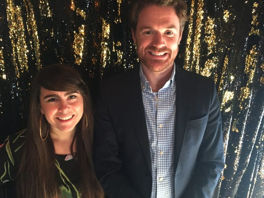 Burlington singer Kat Wright and Ben Cadwallader, executive director of the Vermont Symphony Orchestra, pose for a photo at Radio Bean in Burlington on Oct. 15, 2019.