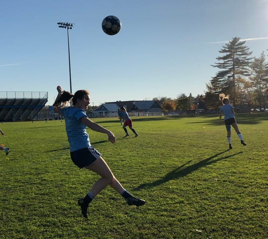 Katie O'Hara heads the ball during South Burlington High soccer practice October 21, 2019.