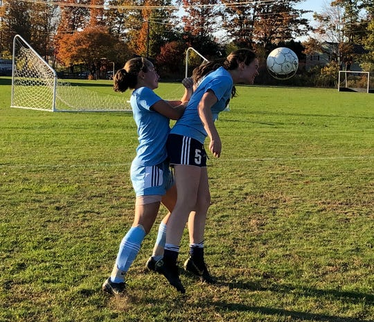 Grace Johnson and Katie O'Hara vie for the ball during South Burlington High soccer practice on October 21, 2019.