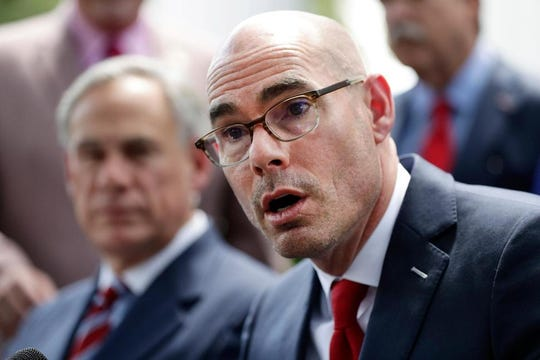 """In this May 23, 2019, file photo, Texas House Speaker Dennis Bonnen, right, with Gov. Greg Abbott, left, speaks at a news conference at the Texas Governor's Mansion in Austin, Texas. Bonnen said in a statement Tuesday, Oct. 22, 2019 he will not run for re-election, making the announcement less than a week after the release of a secretly recorded conversation in which Bonnen sought help ousting members of his own party in 2020 and called a female lawmaker """"vile."""""""