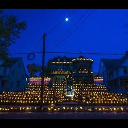 The Mount Holly Pumpkin Festival is in its 16th year. Rich and Deann Denisar allow visitors to come to their home, carve pumpkins, eat snacks and have a good time. The pumpkins are left behind and put on display with little lights inside.  This is a photo from a previous year at the festival.