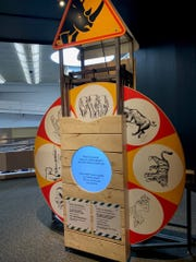 This wheel, part of the 'Worst-Case Scenarios' experience at the Franklin Institute, was designed by a Mount Laurel firm. It offers tips on escaping attacks by various wild animals.