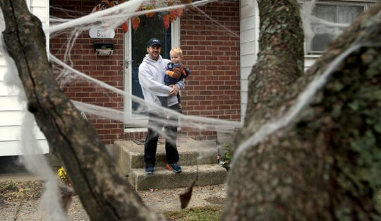 "Mario Cerrito stands with his 3-year-old son Mario in front of their family's Mantua home. The family was spooked enough by apparitions and ""aggressive paranormal activity"" in their home to call in a ghost investigator and will be featured in a Travel Channel episode of ""Ghost Nation"", a new cable show about haunted houses, on Friday."
