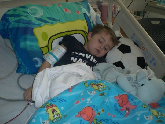 Max Meyer rests while undergoing a blood transplant to treat aplastic anemia.