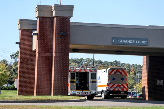 Ambulances park under an awning outside of the emergency care entrance at Tennova Healthcare in Clarksville, Tenn., on Tuesday, Oct. 22, 2019.