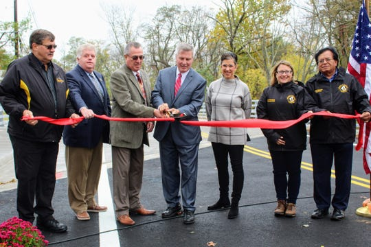 County and municipal officials celebrated the opening of thenew bridge on Baekeland Avenue over the Ambrose Brook in Piscataway Tuesday, according to a release.