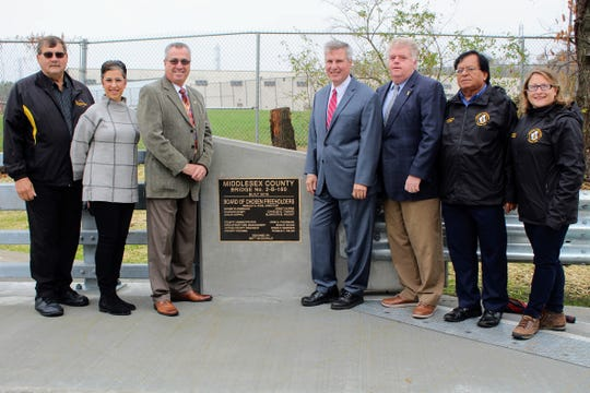 County and municipal officials celebrated the opening of thenew bridge on Baekeland Avenue over the Ambrose Brook Tuesday, according to a release.