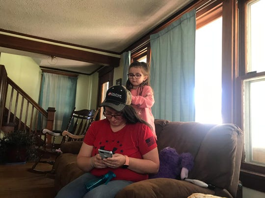 Danielle Wynkoop's daughter Izzabelle comforts her mother on Tuesday, Oct. 22, 2019 in their Webster City home by doing her hair.