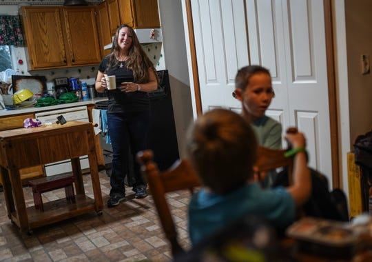 (left to right) Angela Peters, 32, of Commerce Township talks with her sons and Dante Hilton, 7, and Gabriel Peters, 5, after they arrive home in Commerce Township on Monday, October 21, 2019 from school at Keith Elementary School. Peters says her children often come home wanting snacks due to the lack of time they have to eat and have recess at their school.
