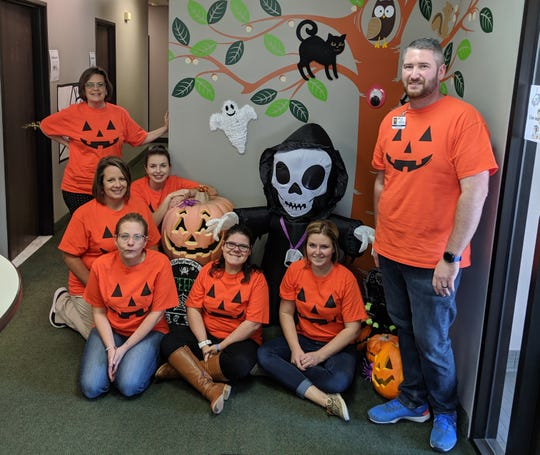 Attendant Care Autism Services staff throws a Halloween open house.