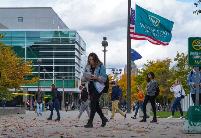 Students walk through the Wayne State University Campus in Detroit on Tuesday, October 22, 2019.
