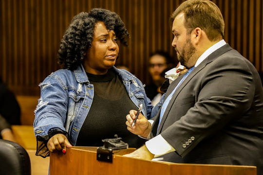 Wade Fink represents Siwatu-Salama Ra, 28, who stands next to him in tears, in Judge Donald Knapp's court on Friday, Oct. 18 during a pretrial hearing to argue the removal of a GPS tether at Frank Murphy Hall of Justice in Detroit on Friday, Oct. 18, 2019.