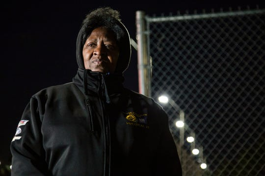 Striker Linda Crooks, 65, of Southfield, a sander on the line pickets outside of GM Detroit-Hamtramck Assembly Tuesday, Oct. 22, 2019.