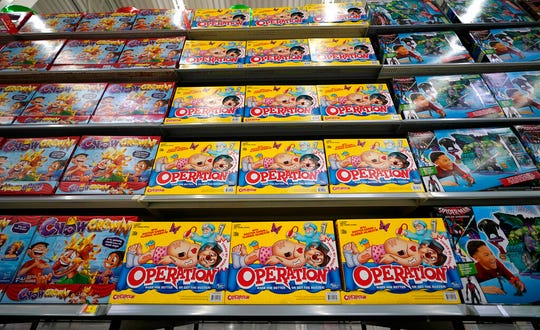 In this Nov. 9, 2018, file photo Operation made by Hasbro is displayed shelves in the expanded toy section at a Walmart Supercenter in Houston. Shares of Hasbro are plunging after the company said the trade war is hammering its supply chain. The toymaker on Tuesday reported third-quarter net income of $212.9 million, or $1.67 per share.