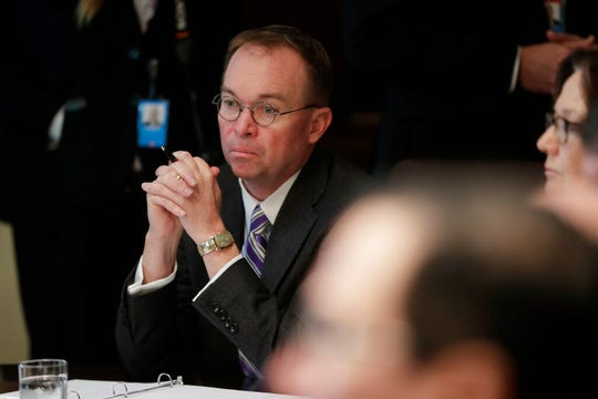 White House Chief of Staff Mick Mulvaney listers as President Donald Trump speaks during a Cabinet meeting in the Cabinet Room of the White House, Monday, Oct. 21, 2019, in Washington. Trump has for weeks been privately testing the idea of replacing Mulvaney.