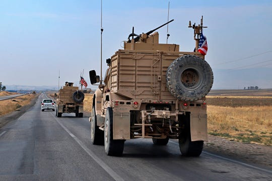 A U.S. military convoy arrives near Dahuk, Iraqi, Monday, Oct. 21, 2019. Defense Secretary Mark Esper said Monday that under the current plan all U.S. troops leaving Syria will go to western Iraq and the military will continue to conduct operations against the Islamic State group to prevent its resurgence.
