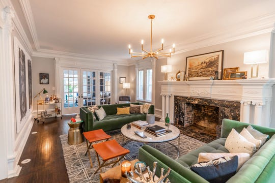The three-story house with five bedrooms,four baths and over 4,300 square feet of living space, was builtin 1920, and is being offered for sale at just under half a million dollars.