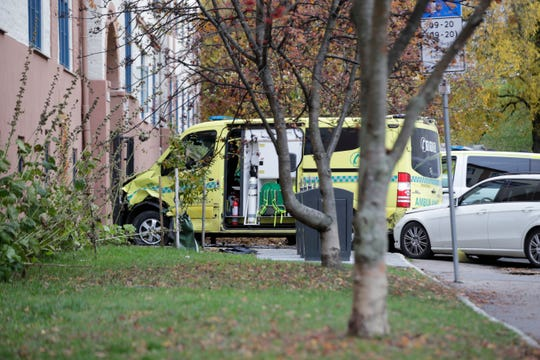 A damaged ambulance is seen parked after an incident in the center of Oslo, Tuesday, Oct. 22, 2019.
