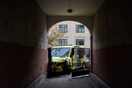 A damaged ambulance is seen parked after it crashed following an incident in the center of Oslo, Tuesday, Oct. 22, 2019.