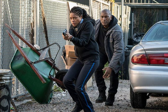 """Naomie Harris and Tyrese Gibson in """"Black and Blue."""""""