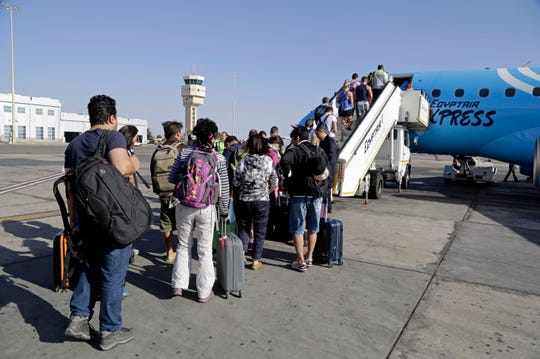 In this Nov. 9, 2015 file photo, passengers board an Egyptair Express plane bound for Cairo at Sharm el-Sheikh Airport, south Sinai, Egypt.