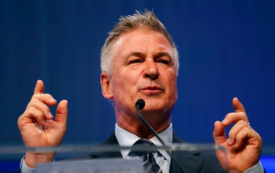 """In this Monday, Nov. 27, 2017, file photo, actor Alec Baldwin speaks during the Iowa Democratic Party's fall gala, in Des Moines, Iowa. Baldwin, known for his mocking impersonations of President Donald Trump on """"Saturday Night Live,"""" is coming to Virginia to help Democratic legislative candidates. Baldwin is set to knock on doors, make calls and deliver pizza to volunteers at multiple stops around Virginia on Tuesday, Oct. 22, 2019."""