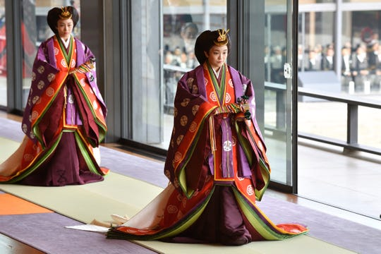 Japan's Princess Mako, right, attends the enthronement ceremony where Emperor Naruhito officially proclaimed his ascension to the Chrysanthemum Throne at the Imperial Palace in Tokyo, Tuesday, Oct 22, 2019.