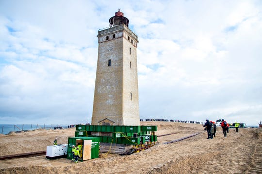The Rubjerg Knude Lighthouse is being moved in Jutland, Denmark, Tuesday, Oct. 22, 2019.