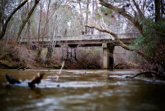 This Feb. 22, 2018, file photo shows a bridge that spans the Apalachee River at Moore's Ford Road where in 1946 two young black couples were stopped by a white mob who dragged them to the riverbank and shot them multiple times in Monroe, Ga. The gruesome lynching is prompting a U.S. court to consider whether federal judges can order grand jury records unsealed in old cases with historical significance.