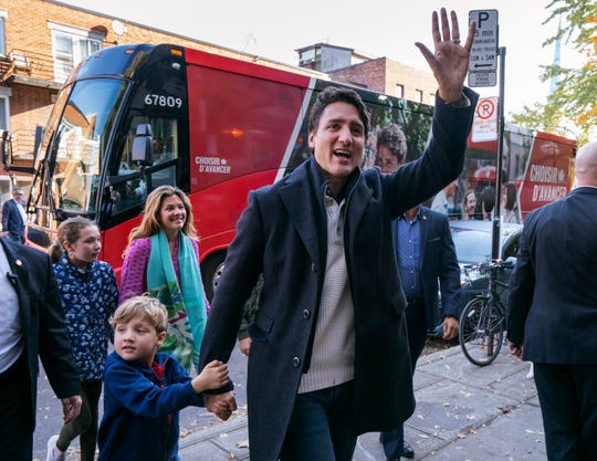 Canadian Prime Minister and Liberal leader Justin Trudeau arrives at the poling station with his son Hadrian, his wife Sophie and daughter Ella-Grace in Montreal, Monday, Oct. 21, 2019.