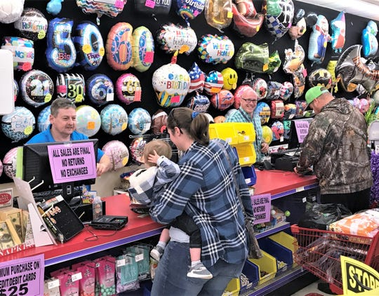 Customers take advantage of deep discounts at Party Time across from the Arnot Mall in Big Flats. The store plans to close in November.
