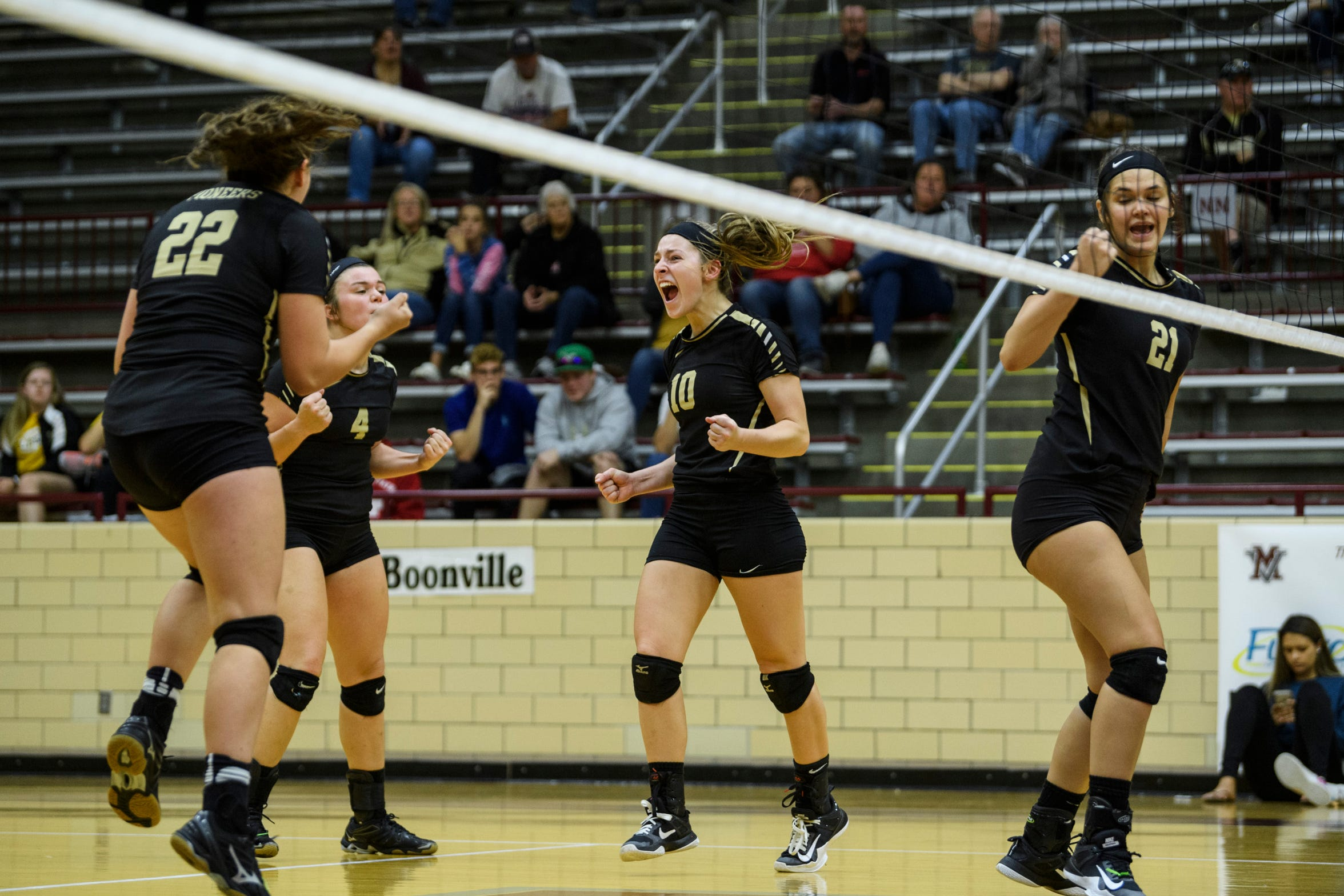 Boonville volleyball players react to a winning point against Memorial in the Class 3A sectional at Mount Vernon last year.