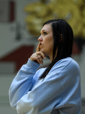 Memorial's head coach Andi Allford watches her team take on the Boonville Pioneers during the IHSAA Class 3A sectional semifinal at Mount Vernon High School in Mount Vernon, Ind., Saturday, Oct. 19, 2019. The Tigers won all three sets to move on to the sectional championship against Heritage Hills.