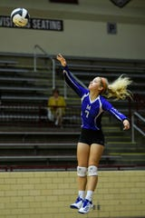 Memorial's Rachel Basinski (7) serves the ball during the IHSAA Class 3A sectional semifinal at Mount Vernon High School. Basinski has helped lead the Tigers to a 31-1 record and a semistate appearance.