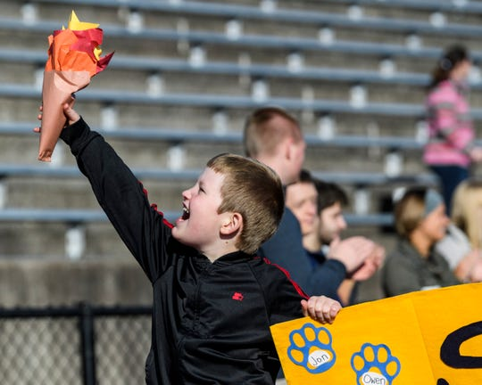 Scott Elementary School student Will Perkins helps carry his school's banner during the opening ceremony parade for the Special Education Unified Game Day at Central Stadium in Evansville, Tuesday morning, Oct. 22, 2019. The Evansville Vanderburgh School Corporation hosted Tuesday's event for more than 200 elementary school students and will host another game day for middle school students, Wednesday morning.